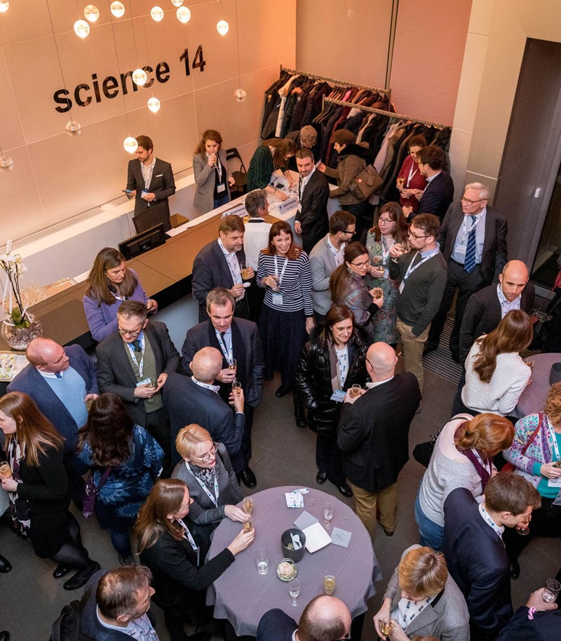 Overhead shot of Science Europe event networking session on their premises
